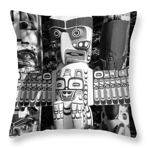 Totem Throw Pillow featuring the photograph Totems by Chris Dutton