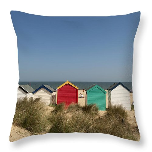 Suffolk Throw Pillow featuring the photograph Traditional Beach Huts In The Sand by Axiom Photographic