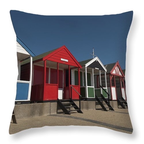 Suffolk Throw Pillow featuring the photograph Traditional Beach Huts On The Seafront by Axiom Photographic