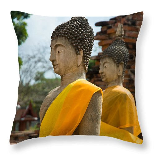 Ancient Throw Pillow featuring the photograph Two Buddha Statues Wrapped In An Orange Scarf by U Schade