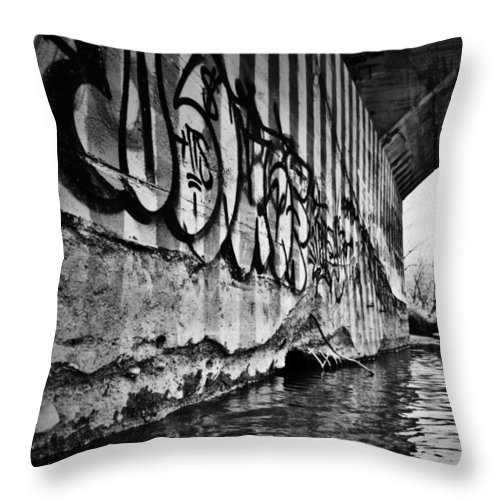 Black And White World Photographer Throw Pillow featuring the photograph Underneath The Bridge by The Artist Project