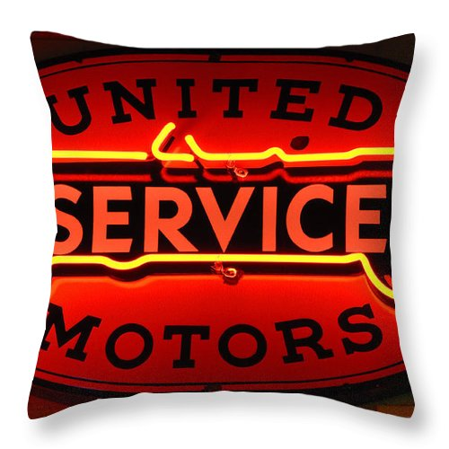 United Motors Service Throw Pillow featuring the photograph United Motors Service Neon Sign by Bob Christopher