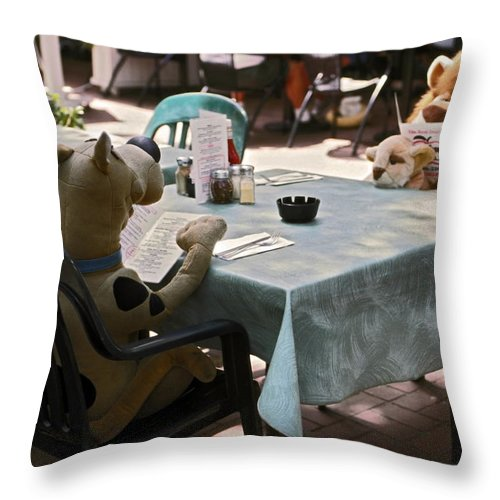 2 Large Stuffed Animals Sitting Reading Menus Throw Pillow featuring the photograph Unusual Diners by Sally Weigand