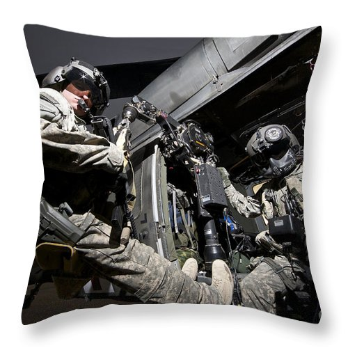 Army Throw Pillow featuring the photograph U.s. Air Force Crew Strapped by Terry Moore