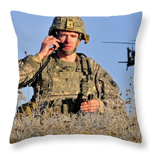 Grafenwoehr Throw Pillow featuring the photograph U.s. Army Captain Directs An Ah-64 by Stocktrek Images