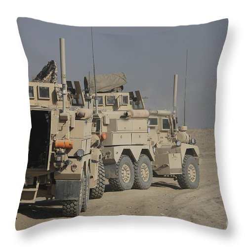 Kunduz Throw Pillow featuring the photograph U.s. Army Cougar Mrap Vehicles by Terry Moore