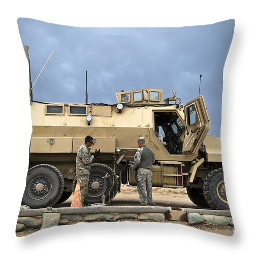 Army Throw Pillow featuring the photograph U.s. Army Sergeant Refuels A Caiman by Stocktrek Images