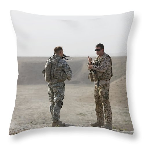 Us Army Throw Pillow featuring the photograph U.s. Army Soldier And German Soldier by Terry Moore