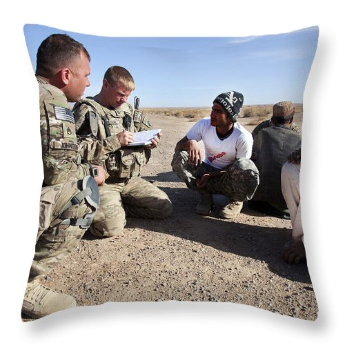 International Security Assistance Force Throw Pillow featuring the photograph U.s. Army Soldiers Speak With Elders by Stocktrek Images