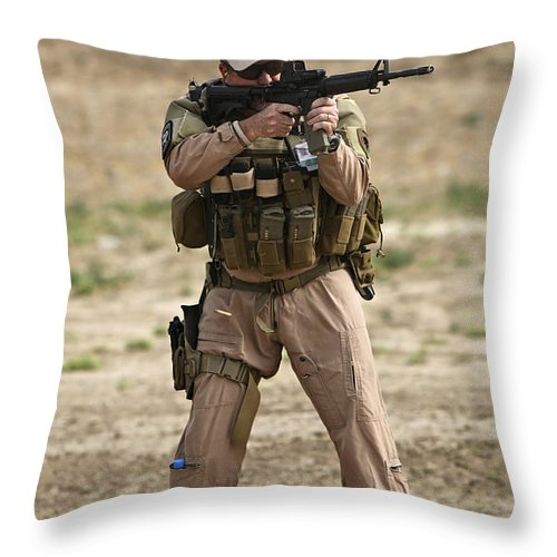 Flight Suit Throw Pillow featuring the photograph U.s. Contractor Firing A M4 Carbine by Terry Moore