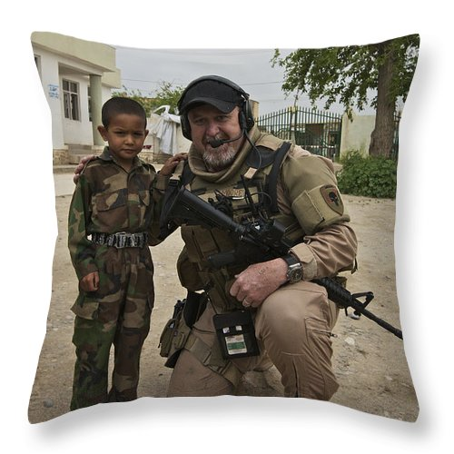 Soldier Throw Pillow featuring the photograph U.s. Contractor Poses For A Picture by Terry Moore