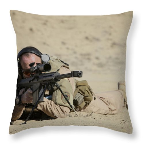 Isaf Throw Pillow featuring the photograph U.s. Contractor Sights In A Barrett by Terry Moore