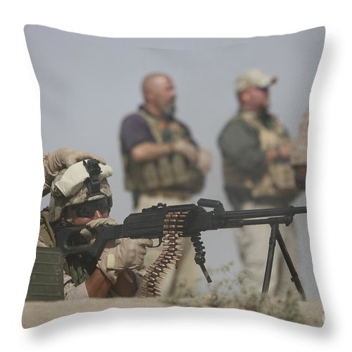 Bullet Throw Pillow featuring the photograph U.s. Marine Firing A Pk 7.62mm Machine by Terry Moore
