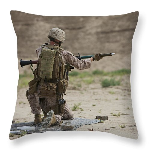 Soldier Throw Pillow featuring the photograph U.s. Marine Prepares A Fragmentation by Terry Moore