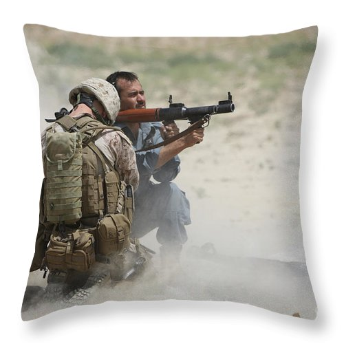 Afghanistan Throw Pillow featuring the photograph U.s. Marine Watches An Afghan Police by Terry Moore