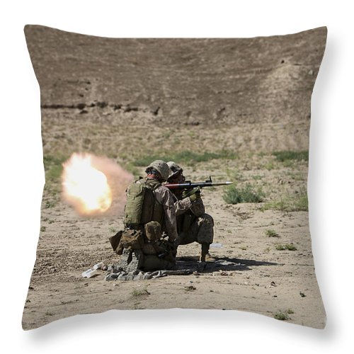 Kunduz Throw Pillow featuring the photograph U.s. Marines Fire A Rocket-propelled by Terry Moore