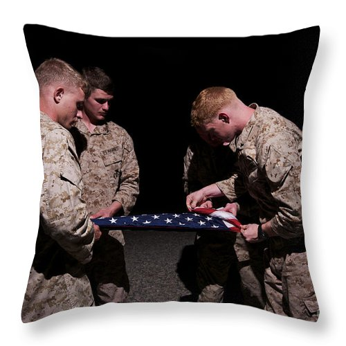 Night Throw Pillow featuring the photograph U.s. Marines Fold The American Flag by Terry Moore
