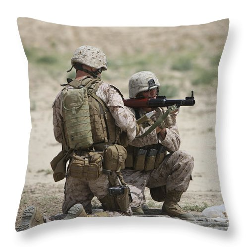 Fragmentation Throw Pillow featuring the photograph U.s. Marines Prepare A Fragmentation by Terry Moore