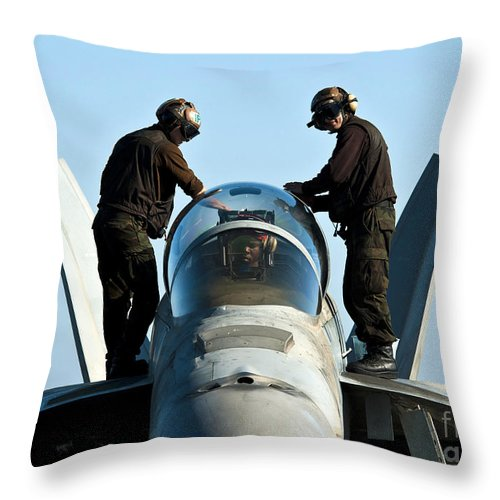 Operation Enduring Freedom Throw Pillow featuring the photograph U.s. Navy Sailors Wipe Down The Canopy by Stocktrek Images