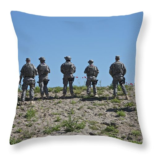 Us Navy Throw Pillow featuring the photograph U.s. Soldiers Looking Over The Side by Terry Moore