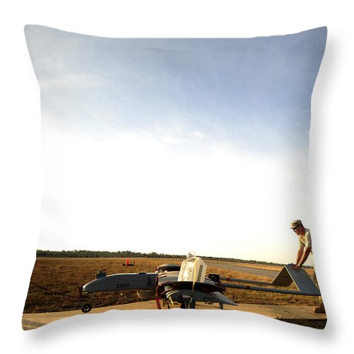 Military Throw Pillow featuring the photograph U.s. Soldiers Prepare To Move An Rq-7 by Stocktrek Images