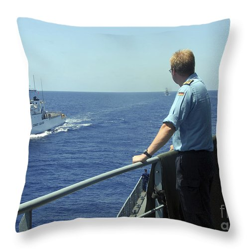 Military Throw Pillow featuring the photograph Uscgc Thetis Approaches A German Combat by Stocktrek Images
