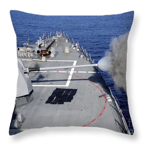 Shooting Throw Pillow featuring the photograph Uss Halsey Fires Its Mk-45 by Stocktrek Images