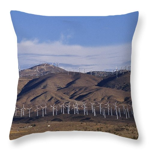 North America Throw Pillow featuring the photograph View Of Windmill Structures On A Wind by Marc Moritsch