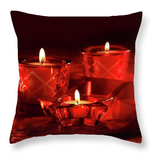 Background Throw Pillow featuring the photograph Votive Candles On Dark Red Background by Sandra Cunningham