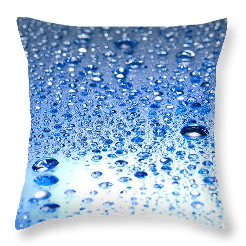 Abstract Throw Pillow featuring the photograph Water Drops On A Shiny Surface by U Schade