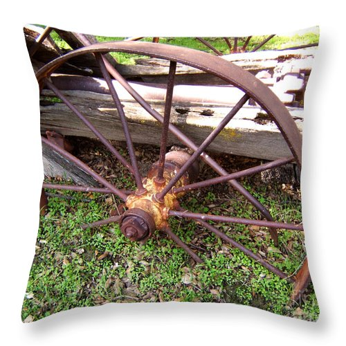 Artoffoxvox Throw Pillow featuring the photograph Wheel In Time Photograph by Kristen Fox