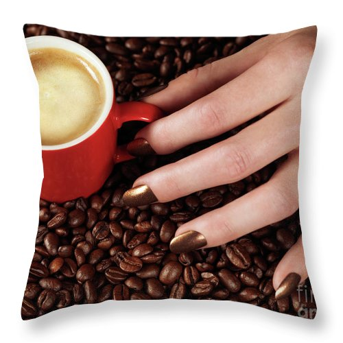 Coffee Throw Pillow featuring the photograph Woman Hand Holding A Cup Of Latte by Oleksiy Maksymenko