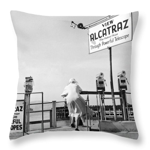 1950's Throw Pillow featuring the photograph Woman Looking At Alcatraz by Underwood Archives