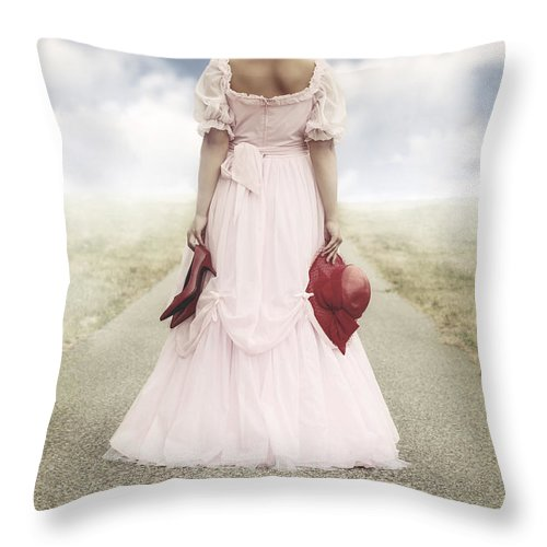 Female Throw Pillow featuring the photograph Woman On A Street by Joana Kruse