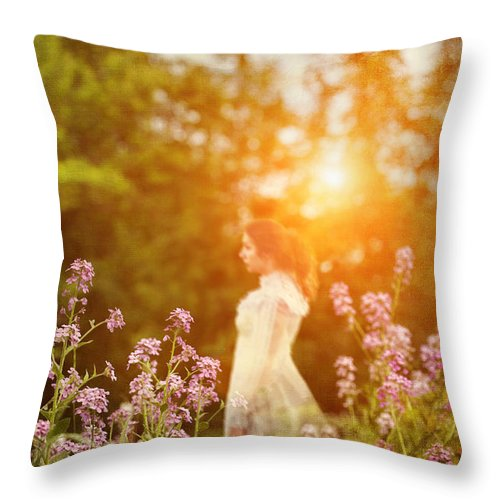 Alone Throw Pillow featuring the photograph Woman Staning Sideways In Garden At Sunset by Sandra Cunningham
