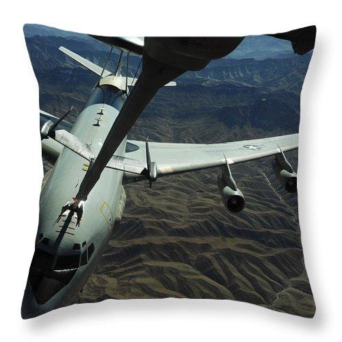 Kc-10 Extender Throw Pillow featuring the photograph A U.s. Air Force E-3 Sentry Aircraft by Stocktrek Images