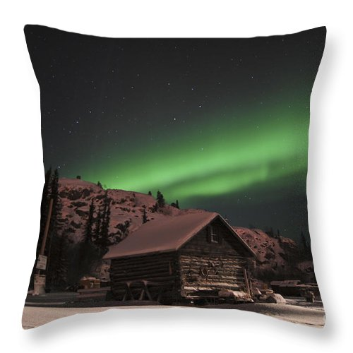 Yellowknife Throw Pillow featuring the photograph Aurora Borealis Over A Cabin, Northwest by Jiri Hermann