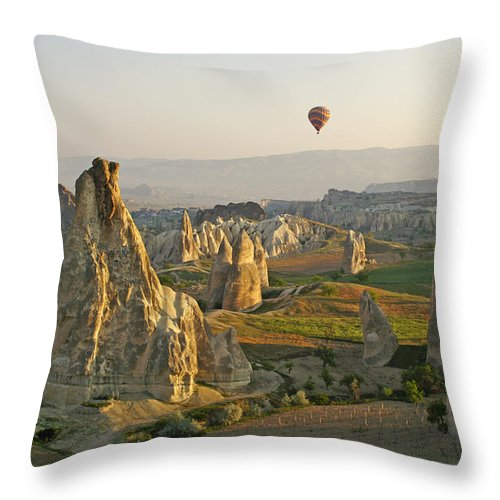 Turkey Throw Pillow featuring the photograph Ballooning In Cappadocia by Michele Burgess