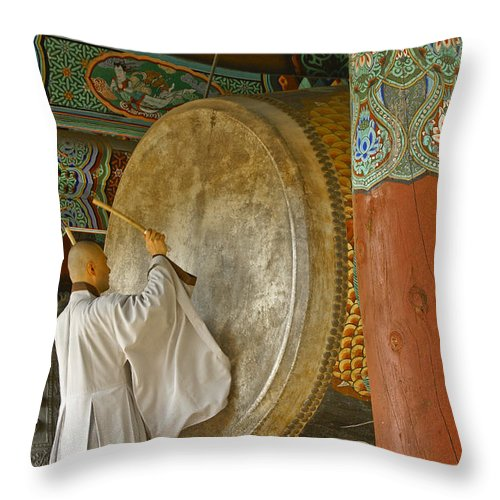 Asia Throw Pillow featuring the photograph Buddhist Monk Drumming by Michele Burgess