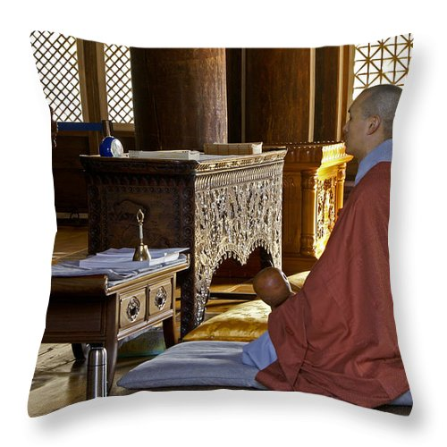 Asia Throw Pillow featuring the photograph Buddhist Monk In Prayer by Michele Burgess