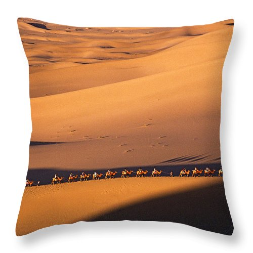 Asia Throw Pillow featuring the photograph Camel Caravan Crosses The Dunes by Michele Burgess