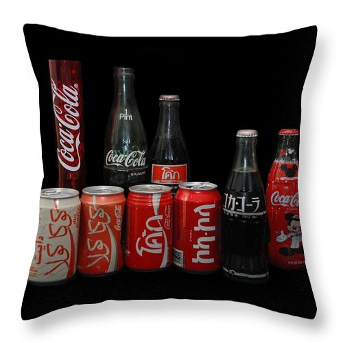 Coca Cola Throw Pillow featuring the photograph Coke From Around The World by Rob Hans