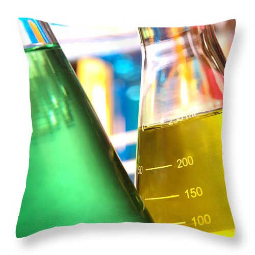 Chemical Throw Pillow featuring the photograph Erlenmeyer Flasks In Science Research Lab by Olivier Le Queinec