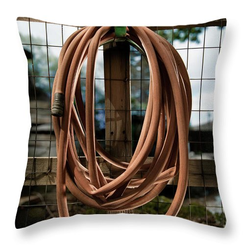 Wood Throw Pillow featuring the photograph Garden Hose by Yo Pedro