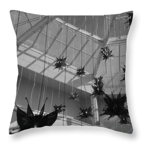 Black And White Throw Pillow featuring the photograph Hanging Butterflies by Rob Hans