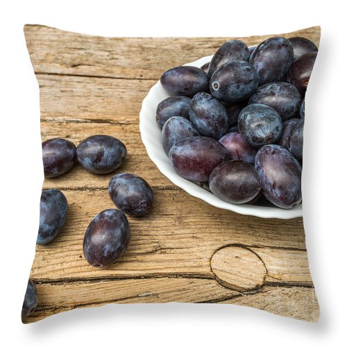 Agriculture Throw Pillow featuring the photograph Plate Full Of Fresh Plums On A Wooden Background by Ranko Maras