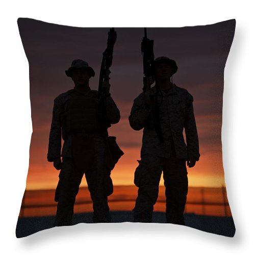 Sandbag Throw Pillow featuring the photograph Silhouette Of U.s Marines On A Bunker by Terry Moore