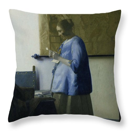 Jan Vermeer Throw Pillow featuring the painting Woman Reading A Letter by Jan Vermeer