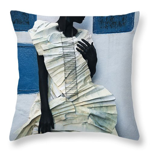 Black Throw Pillow featuring the photograph Woman With Black Boby Paint In Paper Dress by Veronica Azaryan