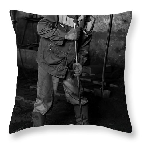 Worker Throw Pillow featuring the photograph Worker In The Foundry by Marat Jolon